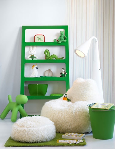 unisex boys girls kids room childrens bedroom childs green shelves white fur chair footstool play area