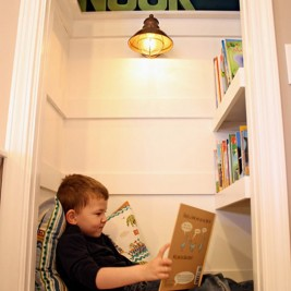 childs converted cupboard reading nook