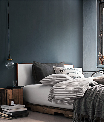 grey gray bedroom exposed bulb light wood pallet bed