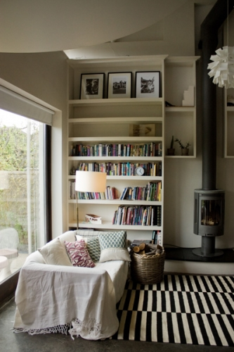 black white living room rug stove bookshelves