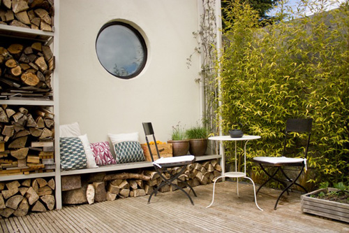 outdoor dining area seaing round window