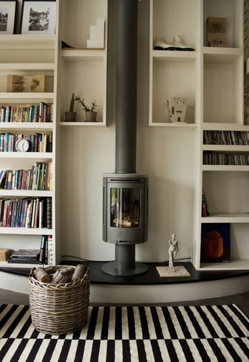white living room built in bookcase stove fireplace