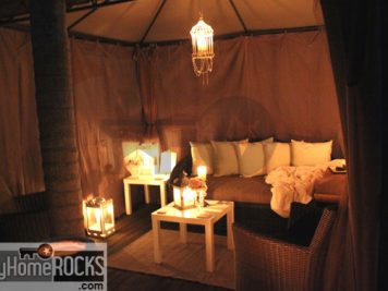 semi permanent outdoor room candle lanterns cushions