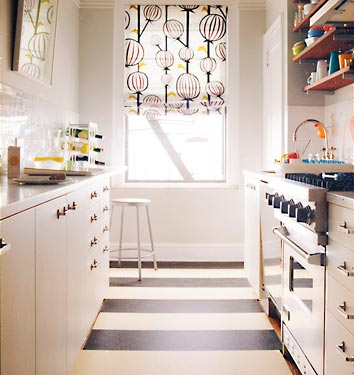 Black white yellow narrow galley style kitchen