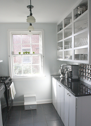 Black white grey galley kitchen open shelving