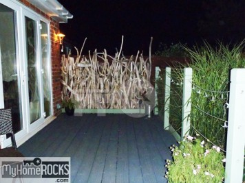 Recycled driftwood fence decking area