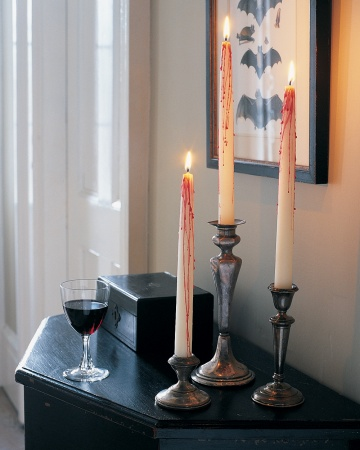 From Martha StewartDrip red wax over white candlesticks for a bloody good effect.