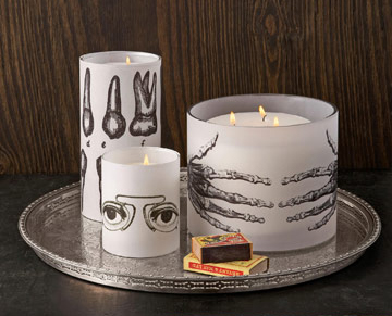 Via DesignfabulousThese candleholders have been wrapped with tracing paper prints to allow the flickering light to shine through the design as the wax burns down. (Do be careful to keep paper clear of a naked flame, and never leave burning candles unattended).