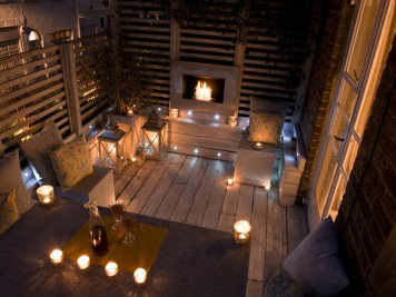 Modern outdoor space patio area with fireplace night