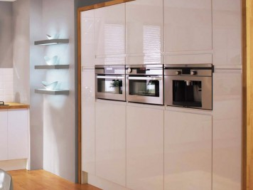Tall white gloss units built in oven