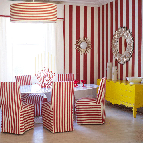 quirky red white stripe dining room yellow sideboard round mirror drum shade