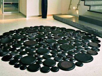 round black rug circles pebbles